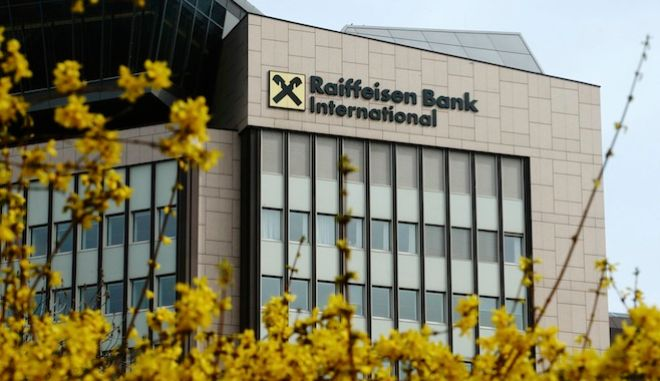 Forsythia blossom in front of the Raiffeisen Bank International (RBI) headquarters in Vienna March 25, 2015. RBI warned on Wednesday it may post a second straight year of losses in 2015 as it books restructuring costs for a major retrenchment after decades of expansion in central and eastern Europe.  REUTERS/Heinz-Peter Bader