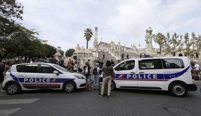 Police cars park outside the Marseille railway station, Sunday, Oct. 1, 2017. French police warn people to avoid Marseille's main train station amid reports of knife attack, assailant shot dead. (AP Photo/Claude Paris)