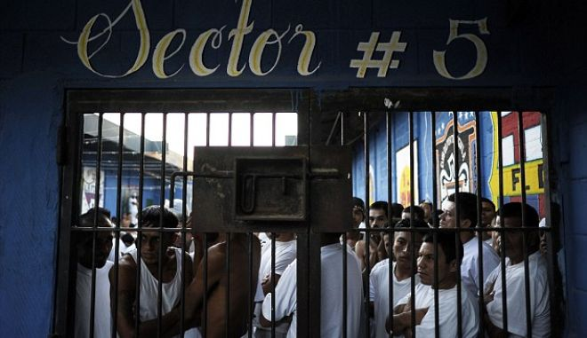 Inmates stand by a door at La Esperaza Jail in San Salvador, on November 23, 2012. La Esperanza, the largest jail in El Salvador, was designed to hold 800 inmates but currently holds 4700 prisoners.  AFP PHOTO/Jose CABEZASJose CABEZAS/AFP/Getty Images