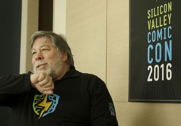 Apple co-founder Steve Wozniak speaks into his Apple Watch while interviewed in San Francisco, Wednesday, Feb. 10, 2016. Wozniak is helping to create the inaugural Silicon Valley Comic Con, which will be held from March 18-20, 2016, in San Jose, Calif. (AP Photo/Jeff Chiu)