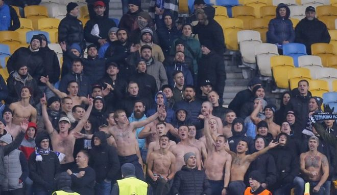 Kiev fans support their team during the Champions League Group B soccer match between Dynamo Kiev and Benfica at the Olympiyskiy stadium in Kiev, Ukraine, Wednesday, Oct. 19, 2016. (AP Photo/Efrem Lukatsky)