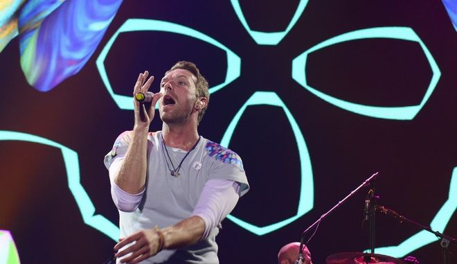 Singer Chris Martin, of the band Coldplay, performs at the Global Citizen Festival concert on the eve of the G-20 summit in Hamburg, northern Germany, Thursday, July 6, 2017. The leaders of the group of 20 meet July 7 and 8. (AP Photo/Jens Meyer)