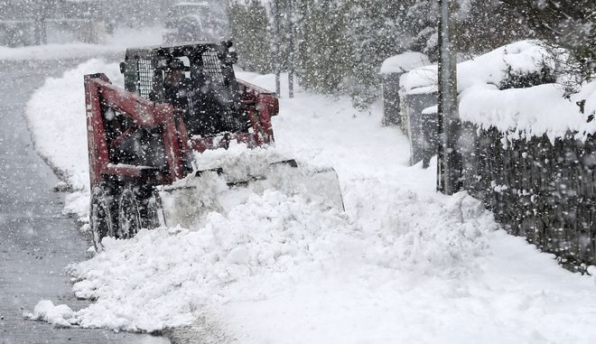 Snow is cleared in Co Kildare, Ireland, Thursday March 1, 2018. Persistent snow and freezing conditions are causing delays in many parts of Britain, with roads and train service hit particularly hard. Emergency officials said many drivers had to be rescued from stranded vehicles. (Niall Carson/PA via AP)