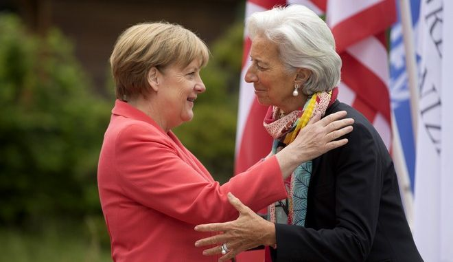 German Chancellor Angela Merkel, left, greets Managing Director of the International Monetary Fund Christine Lagarde during arrivals of G-7 leaders and Outreach guests at the G-7 summit at Schloss Elmau hotel near Garmisch-Partenkirchen, southern Germany, Monday, June 8, 2015. G-7 leaders, in a second and final day of the conference, were set to tackle the difficult issue of climate change and fighting terrorism. (AP Photo/Virginia Mayo)