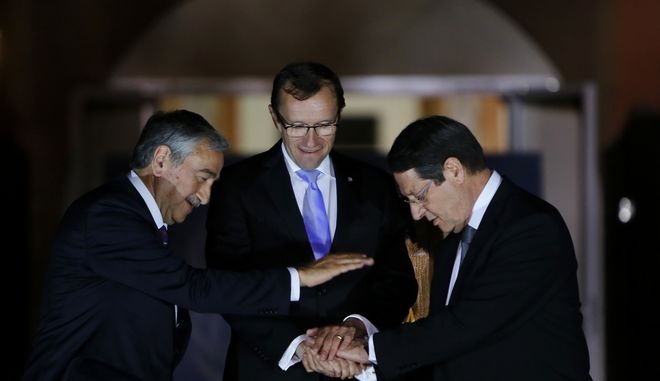 FILE - In this Monday, May 11, 2015 file photo, Cyprus' president Nicos Anastasiades, right, Turkish Cypriot leader Mustafa Akinci, left, and United Nations envoy Espen Barth Eide shake hands after a dinner at the Ledra Palace Hotel inside the UN controlled buffer zone that divides the Cypriot capital Nicosia.  United Nations envoy Espen Barth Eide said in a statement Tuesday, April 4, 2017, stalled talks aimed at reunifying ethnically divided Cyprus will resume next week after a nearly two-month break.  (AP Photo/Petros Karadjias, File)
