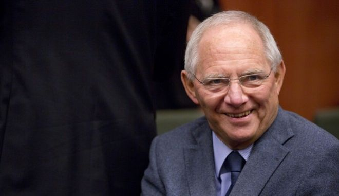 German Finance Minister Wolfgang Schaeuble waits for the start of a meeting of the eurogroup finance ministers at the EU Council building in Brussels on Monday, Dec. 8, 2014. (AP Photo/Virginia Mayo)
