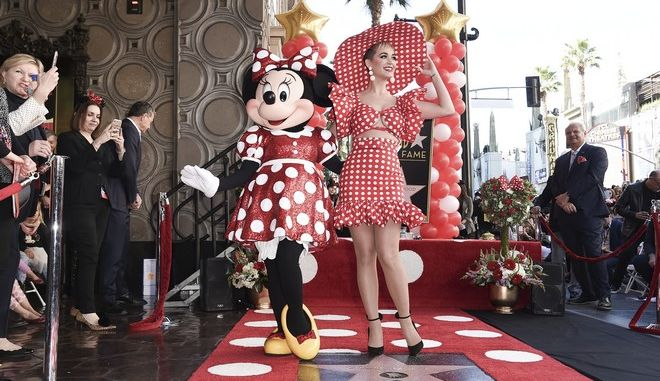 Minnie Mouse, left, and Katy Perry attend a ceremony honoring Minnie with a star on the Hollywood Walk of Fame on Monday, Jan. 22, 2018, in Los Angeles. (Photo by Richard Shotwell/Invision/AP)