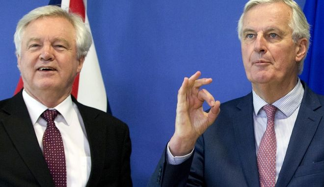 European Union chief Brexit negotiator Michel Barnier, right, gestures as he meets with British Secretary of State for Exiting the European Union David Davis at EU headquarters in Brussels on Monday, March 19, 2018. (Virginia Mayo)