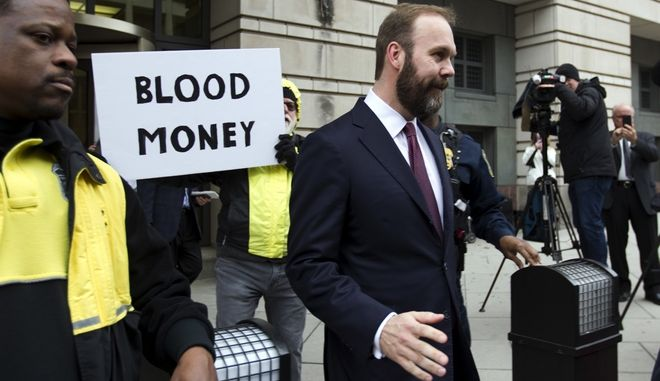 Rick Gates leaves the federal court in Washington, Friday, Feb. 23, 2018. Gates, a former top adviser to President Donald Trump's campaign pleaded guilty in the special counsel's Russia investigation to federal conspiracy and false statements charges. (AP Photo/Jose Luis Magana)