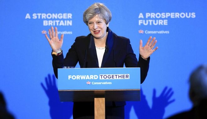CAPTION CORRECTS PHOTOGRAPHER'S BYLINE  Britain's Prime Minister and Conservative party leader Theresa May smiles during the launch of Conservative Party manifesto, in Halifax, England, Thursday May 18, 2017. Britain will head to the polls for a general election on June 8. (Danny Lawson/PA via AP)