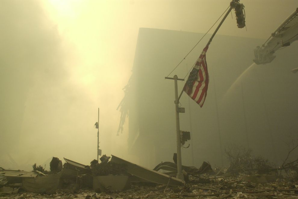 An American flag at ground zero on the evening of Sept. 11, 2001 after the September 11 terrorist attacks on the World Trade Center in New York City.(AP Photo/Mark Lennihan)