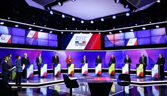 The eleven French presidential election candidates take part in a television debate at French national television France 2, in Saint Cloud, outside Paris, Thursday, April 20, 2017. The 11 men and women hoping to be France's next president are to appear on national television in a last appeal to voters in a nail-biting election campaign. (Martin Bureau/Pool Photo via AP)
