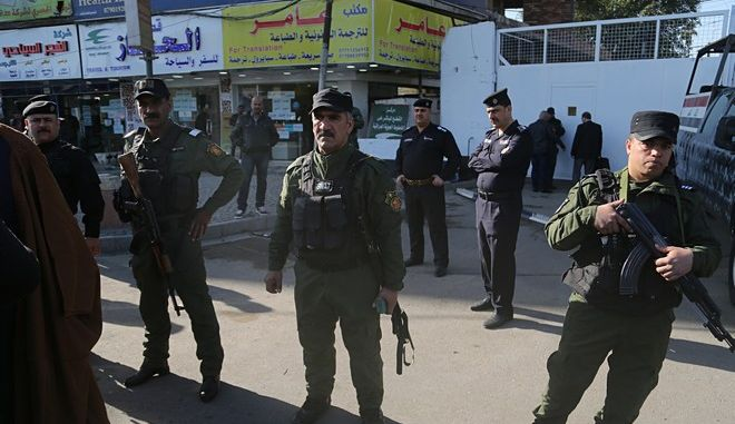 Iraqi security forces protect the French Embassy as demonstrators protest against the French President Emmanuel Macron's decision to dissolve the Popular Mobilization Forces in Baghdad, Iraq, Thursday, Dec. 7, 2017. (AP Photo/Khalid Mohammed)
