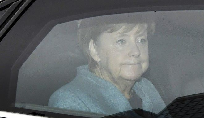 German Chancellor Angela Merkel arrives for a meeting of her Christian Democratic Union party, CDU, at their headquarters in Berlin, Germany, Monday, Sept. 25, 2017, after Sunday's parliament election. (Boris Roessler/dpa via AP)