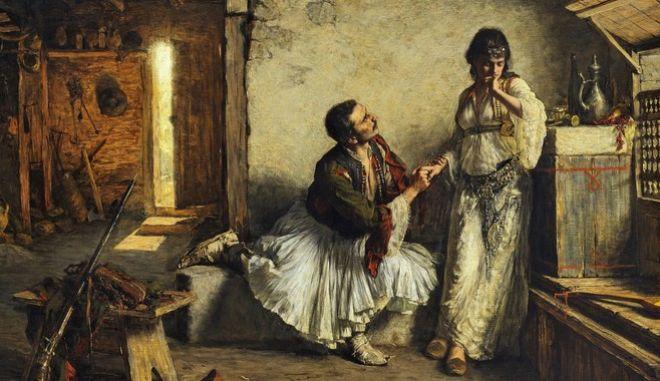Πρόταση γάμου από την εποχή της Επανάστασης, όπου είναι διακριτά τα κοσμήματα της γυναίκας και η λευκή πουκαμίσα που φορούσαν από το πρωί έως το βράδυ -μέσα από άλλες ενδυμασίες ή μόνη.