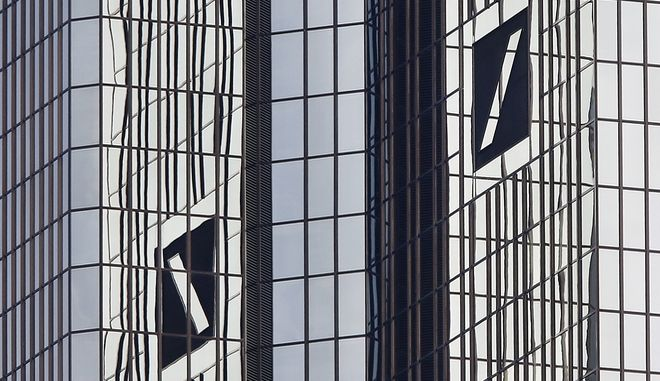 The logos are pictured at he headquarters of Deutsche Bank in Frankfurt, Germany, Tuesday, Oct. 11, 2016. (AP Photo/Michael Probst)