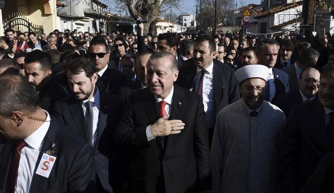 Turkish President Recep Tayyip Erdogan thanks the crowd as he goes to the Minority School in the northeastern Greek town of Komotini, Friday, Dec. 8, 2017. Erdogan has met with members of Greece's Muslim minority, ending a landmark visit to Greece that sharply divided opinion in the country and saw tensions in relations resurface. (AP Photo/Giannis Papanikos)