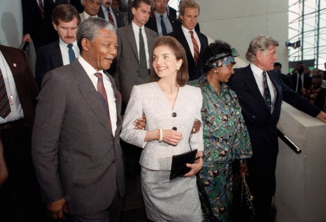 Jacqueline Kennedy Onassis casts a smiling glance at Nelson Mandela, deputy president of the African National Congress, during Mandela's visit to the John F. Kennedy Library on June 23, 1990 in Boston. The Kennedy family has been a longtime opponent of South Africa's policy of apartheid. (AP Photo/Peter Southwick)