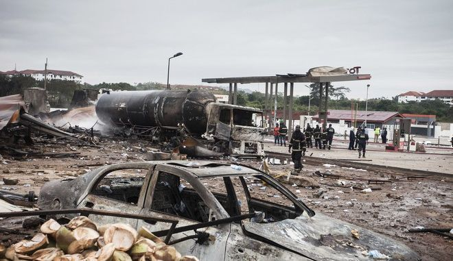 Firemen at the site of Saturday's gas tanker explosion in Accra, Ghana. Sunday Oct. 8, 2017. Ghana's deputy information minister says a tanker explosion at a gas-filling station, followed by a secondary blast, has left a number of casualties in the Legon suburb in northwest Accra. (AP Photo/Richmond Brentuo)