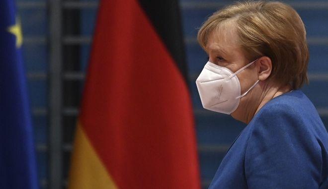 German Chancellor Angela Merkel arrives to lead the weekly cabinet meeting on Wednesday, Jan. 6, 2021 at the Chancellery in Berlin, Germany. (John MacDougall/Pool via AP)