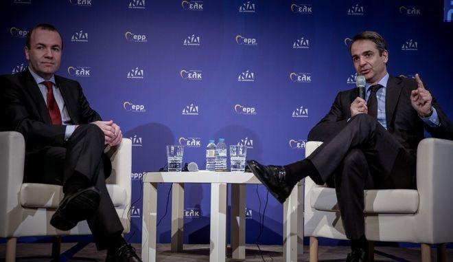 Δημόσια συζήτηση του Κυριάκου Μητσοτάκη με τον Μάνφρεντ Βέμπερ με επίκεντρο τις εξελίξεις στην Ελλάδα, στα πλαίσια της συνεδρίασης του προεδρείου του Ευρωπαϊκού Λαϊκού Κόμματος, στην Αθήνα την Πέμπτη 7 Φεβρουαρίου 2019. (EUROKINISSI/ΣΤΕΛΙΟΣ ΜΙΣΙΝΑΣ)