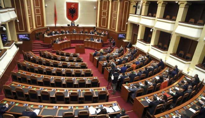 Albanian Lawmakers take part in an parliament session as the seats of the main opposition Democratic party, left, are empty, in Tirana, Tuesday, April 11, 2017. The Albanian Parliament has failed to create a commission that will select the vetting bodies which will evaluate the personal and professional backgrounds of judges and prosecutors because of a boycott from the opposition.(AP Photo/Hektor Pustina)