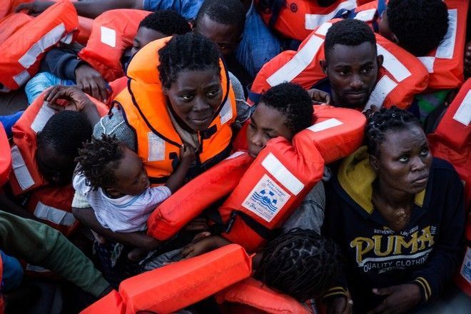 Medecins Sans Frontieres (MSF) and the Bourbon Argos 136 people are found in an overcrowded rubber boat in the Central Mediterranean, containing many women and children.