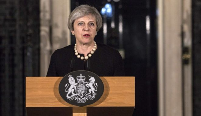 Britain's Prime Minister Theresa May gives a media statement outside 10 Downing street in London, Wednesday March 22, 2017, following a terror attack in the Westminster area of London earlier Wednesday.  A knife-wielding man went on a deadly rampage, Wednesday, plowing a car into pedestrians on London's Westminster Bridge before stabbing an armed police officer to death inside the gates of Parliament. Four people were killed, including the attacker, and about 20 others were injured in what authorities called a terrorist incident. (Richard Pohle/Pool via AP Photo)