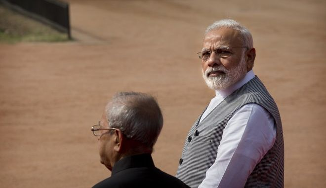 Indian Prime Minister Narendra Modi, right, and President Pranab Mukherjee wait for the arrival of Nepalese President Bidya Devi Bhandari at the Indian presidential palace in New Delhi, India, Tuesday, April 18, 2017. Bhandari is on a five day official visit to India. (AP Photo/Manish Swarup)