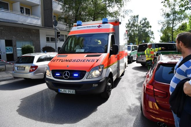 An ambulance arrives  near a subway station in Munich, Germany, Tuesday, June 13, 2017.  Several people were injured, including a police officer, in a shooting early Tuesday at a Munich subway station, police said. Munich police said in a tweet that the policewoman's injuries were serious. The suspect was also injured and is in custody. The shooting occurred during a morning police check at the Unterfoehring subway station, Munich police spokesman Michael Riehlein said. (Sven Hoppe/dpa via AP)