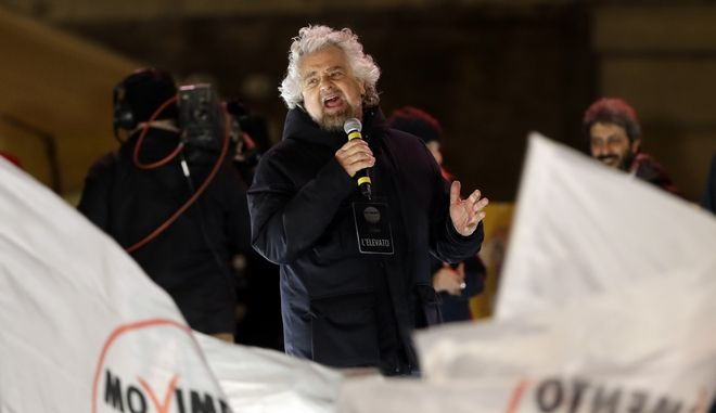 Five-Star Movement (M5S) founder Beppe Grillo, attends his party's final rally in Rome, Friday, March 2, 2018. General elections in Italy will be held Sunday. (AP Photo/Andrew Medichini)