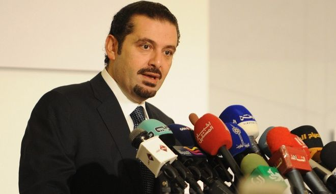Lebanese Prime Minister Saad Hariri delivers a speech during the opening of the second Kuwait Financial Forum, sponsored by the Kuwaiti premier Sheikh Nasser Mohammad Al-Ahmad Al-Jaber Al-Sabah in Kuwait on Sunday, Oct. 31, 2010. (AP Photo/Gustavo Ferrari)