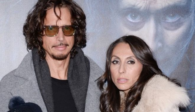 """Chris Cornell poses with his wife Vicky and their children at the premiere of """"Into The Woods"""" at the Ziegfeld Theatre on Monday, Dec. 8, 2014, in New York. (Photo by Evan Agostini/Invision/AP)"""