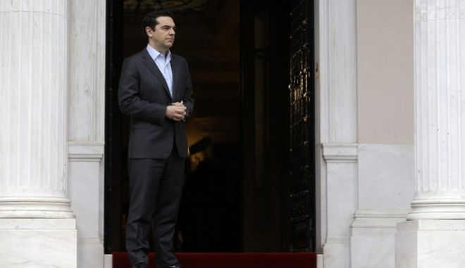Greek Prime Minister Alexis Tsipras waits for the arrival of German President Frank-Walter Steinmeier at Maximos Mansion in Athens, Friday, April 7, 2017. Greece and its international creditors took a big step Friday toward an agreement that will ensure the country gets the money it needs to avoid a potential bankruptcy this summer but which could spell more pain for austerity-weary Greeks. (AP Photo/Thanassis Stavrakis)
