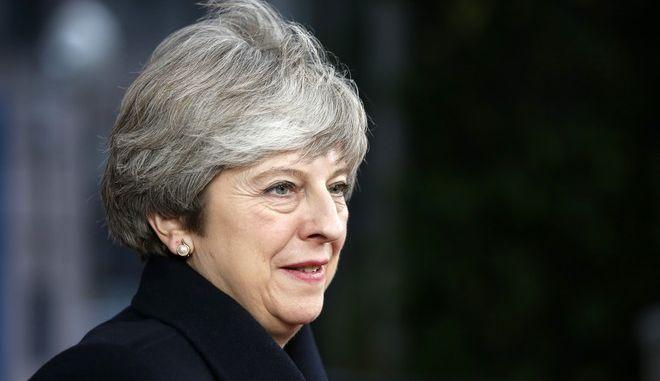 British Prime Minister Theresa May arrives for an EU summit at the Europa building in Brussels on Thursday, Dec. 14, 2017. European Union leaders are gathering in Brussels and are set to move Brexit talks into a new phase as pressure mounts on Prime Minister Theresa May over her plans to take Britain out of the 28-nation bloc. (Francois Lenoir, Pool Photo via AP)