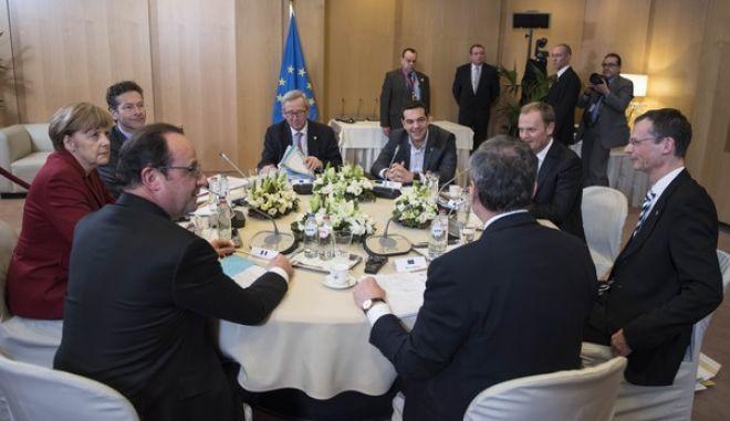 Στιγμιότυπο από την επταμερή σύσκεψη για την Ελλάδα, στο περιθώριο της Συνόδου Κορυφής την Παρασκευή 20 μαρ΄τιου 2015, στις Βρυξέλλες. (ΓΡΑΦΕΙΟ ΤΥΠΟΥ ΠΡΩΘΥΠΟΥΡΓΟΥ/ANDREA BONETTI/EUROKINISSI)
