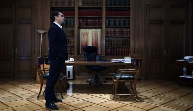 Greece's Prime Minister Alexis Tsipras waits for EU Finance Commissioner Pierre Moscovici at Maximos Mansion in Athens, Wednesday, Feb. 15, 2017. Tsipras' left-led government was hoping by next week to conclude dragging negotiations on spending cuts and reforms demanded by Greece's European creditors and the International Monetary Fund. (AP Photo/Thanassis Stavrakis)