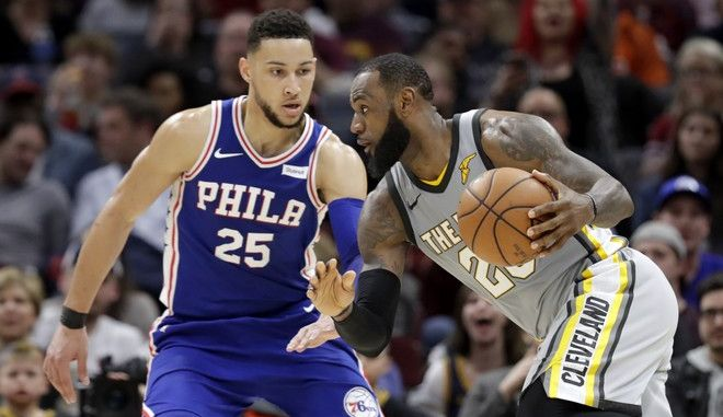 Cleveland Cavaliers' LeBron James (23) drives abasing Philadelphia 76ers' Ben Simmons (25), from Australia, in the second half of an NBA basketball game, Thursday, March 1, 2018, in Cleveland. (AP Photo/Tony Dejak)