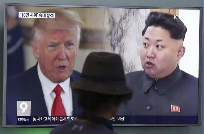 FILE - In this Aug. 10, 2017, file photo, a man watches a TV screen showing U.S. President Donald Trump and North Korean leader Kim Jong Un, right, during a news program at the Seoul Train Station in Seoul, South Korea. Trump's latest tweets on North Korea received a muted response in South Korea, where media focused Monday, Oct. 2, 2017, more on U.S. Secretary of State Rex Tillerson's acknowledgement that the U.S. is keeping communication channels open with the North. (AP Photo/Ahn Young-joon, File)