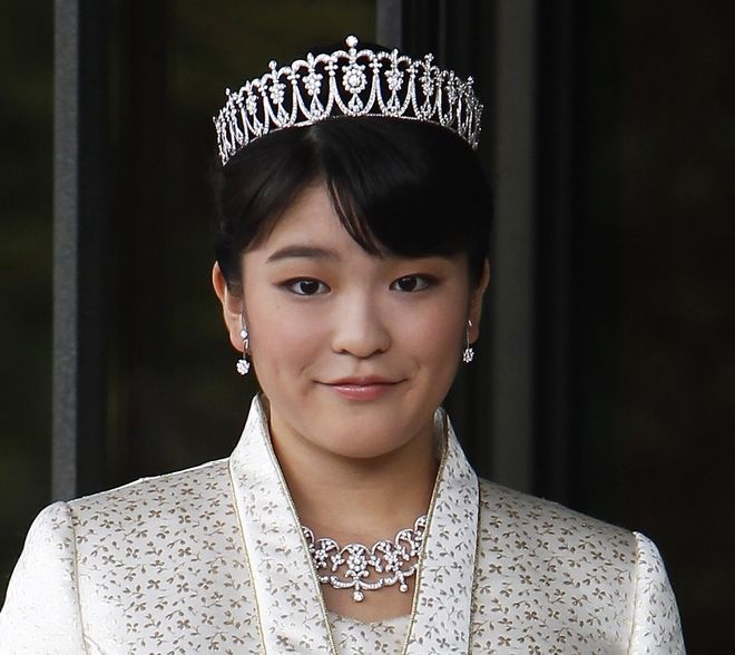 FILE - In this Oct. 23, 2011, file photo, Japan's Princess Mako, the first daughter of Prince Akishino and Princess Kiko, poses for photos at Imperial Palace in Tokyo. Mako, the granddaughter of Emperor Akihito, is getting married to an ocean lover who can ski, play the violin and cook, according to public broadcaster NHK TV. The Imperial Household Agency declined to confirm the report Tuesday, May 16, 2017. (AP Photo/Shizuo Kambayashi, File)