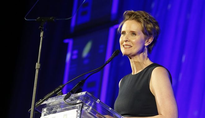 """FILE - In this Feb. 3, 2018 file photo, Cynthia Nixon, former star of """"Sex and the City,"""" is honored by The Human Rights Campaign with an HRC Visibility Award in New York. Nixon said on Twitter Monday, March 19, 2018 that she'll challenge Gov. Andrew Cuomo in New York's Democratic primary in September. Her announcement sets up a race pitting an openly gay liberal activist against a two-term incumbent with a $30 million war chest and possible presidential ambitions. (Jason DeCrow/AP Images for Human Rights Campaign, File)"""