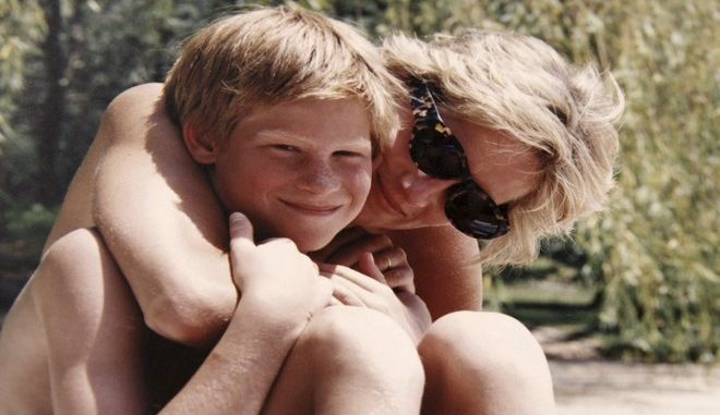 In this photo made available by Kensington Palace from the personal photo album of the late Diana, Princess of Wales, shows the princess and Prince Harry on holiday, and features in the new ITV documentary 'Diana, Our Mother: Her Life and Legacy.' Prince William and Prince Harry will pay tribute to their mother, Princess Diana, as the 20th anniversary of her death in a car crash approaches in a TV documentary Diana, Our Mother: Her Life and Legacy which will air Monday July 24, 2017 on British TV. (The Duke of Cambridge and Prince Harry/Kensington Palace via AP)  NO USE ON THE FRONT COVERS OF ANY UK OR INTERNATIONAL MAGAZINES. NO COMMERCIAL USE (including any use in merchandising, advertising or any other non-editorial use including, for example, calendars, books and supplements).