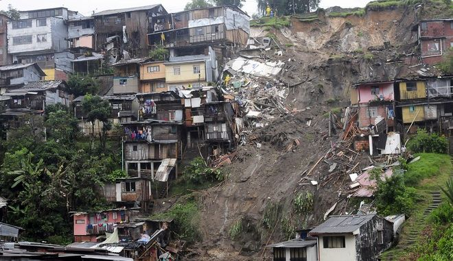 View of a landslide that destroyed several houses in Manizales, Colombia, Wednesday, April 19, 2017. At least seven people are dead after intense rains provoked several landslides in a mountainous, coffee-growing part of Colombia. (AP Photo/Maria Luisa Garcia)