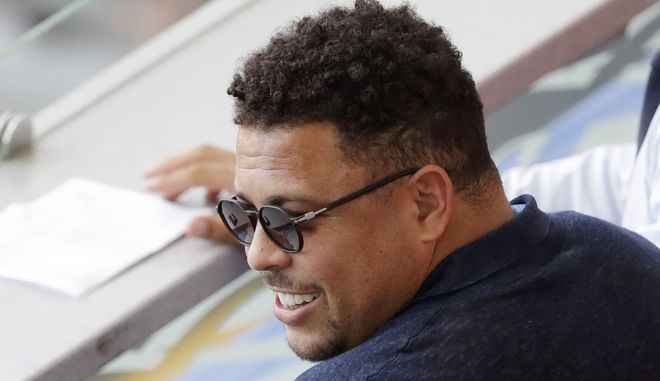 FILE  - In this  June 30, 2018, Brazil's former player Ronaldo watches a match between France and Argentina,at the 2018 soccer World Cup at the Kazan Arena in Kazan, Russia. Ronaldo said on Sunday, Aug. 12, 2018 that he has been hospitalized since Friday because of flu, and expects to return home on Monday. (AP Photo/Sergei Grits, File)
