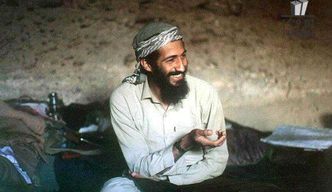 1988, Afghanistan --- Saudi-born billionaire Osama Bin Laden smilies as he sits in a cave in the Jalalabad region of Afghanistan.  --- Image by © epa/Corbis