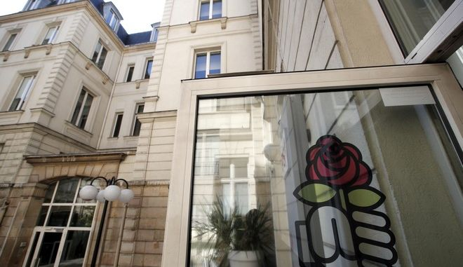 The entrance of the socialist party headquarters is pictured in Paris, Wednesday, Sept. 20, 2017. France's Socialists, who are reeling from this year's damaging electoral defeat, are so broke they are putting their famed Paris headquarters up for sale. (AP Photo/Christophe Ena)