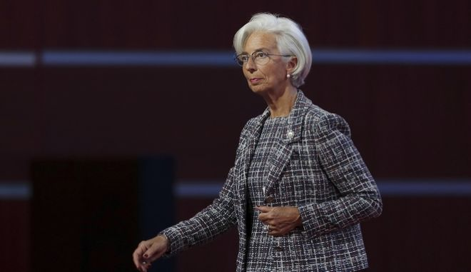 International Monetary Fund Managing Director Christine Lagarde walks during the Belt and Road Forum for International Cooperation in Beijing Sunday, May 14, 2017. (Lintao Zhang/Pool Photo via AP)