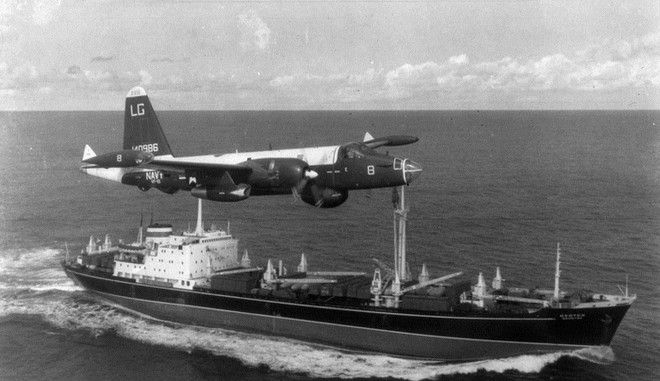 AT SEA:  (EDITORIAL USE ONLY)  (FILE PHOTO)  A P2V Neptune U.S. patrol plane flies over a Soviet freighter during the Cuban missile crisis in this 1962 photograph. Former Russian and U.S. officials attending a conference commemorating the 40th anniversary of the missile crisis October 2002 in Cuba said that the world was closer to a nuclear conflict during the 1962 standoff between Cuba and the U.S., than governments were aware of.  (Photo by Getty Images)