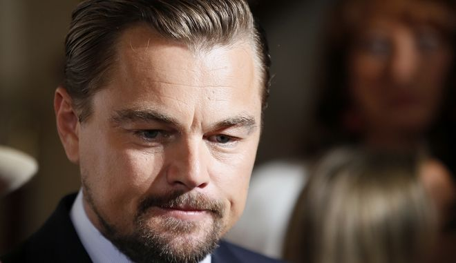 Actor Leonardo Di Caprio arrives for a photo call for the french premiere of the film 'Before the Flood', ('Avant Le Deluge') at Chatelet Theater in Paris, Monday Oct. 17, 2016. (AP Photo/Francois Mori)