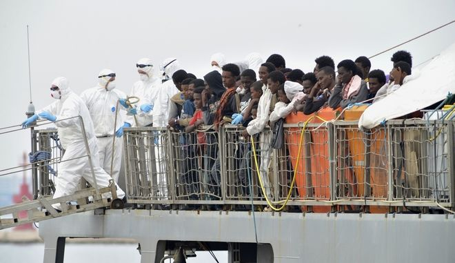 Rescued migrants wait to disembark from the Irish Navy ship Le Eithne at the Taranto harbor, Italy, Monday, June 8, 2015. Heartened by recent election successes by an anti-immigrant party, Italian politicians based in the north vowed Sunday not to shelter any more migrants saved at sea, even as thousands more were being rescued in the Mediterranean from smugglers' boats in distress. (AP Photo/Gaetano Lo Porto)